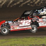Bobby Pierce (32) races under John Blankenship during Friday's Lucas Oil Late Model Dirt Series event at Tri-City Speedway. (Don Figler Photo)