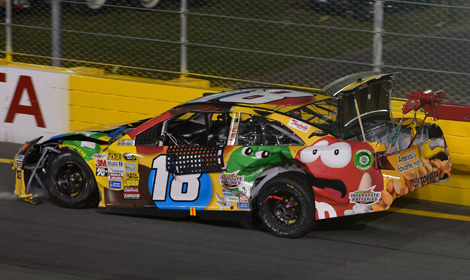 Kyle Busch's damaged Toyota gets towed to the garage after a crash int he second segment of the NASCAR Sprint All-Star Race Saturday at Charlotte Motor Speedway. (NASCAR Photo)