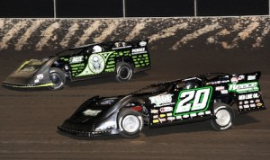 Scott Bloomquist (0) battles Jimmy Owens en route to winning Friday's Lucas Oil Late Model Dirt Series feature at Tri-City Speedway. (Don Figler photo)