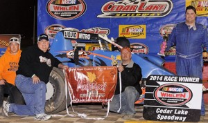 Rob Caho Jr. stands in victory lane after winning Saturday's  UMSS Traditional Sprint Car Series feature at Cedar Lake Speedway. (Track Rat Photo)