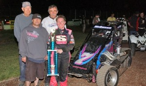 Shannon McQueen with her crew following her BCRA midget win at the Stockton (CA) Fairgrounds.  With her are team members Bob Holland, Wayne McQueen, former driver Rob Russell and McQueen. (M&M photo)