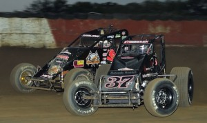 Jon Stanbrough (37) battles eventual winner Dave Darland Wednesday night at the Terre Haute (Ind.) Action Track. (David E. Heithaus photo)