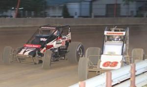 Kody Swanson (63) races under Chris Windom Thursday night at the Indiana State Fairgrounds. (Gordon Gill photo)