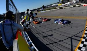 Elliott Sadler (11) races towards the checkered flag to win Saturday's NASCAR Nationwide Series Aaron's 312 at Talladega Superspeedway. (NASCAR Photo)