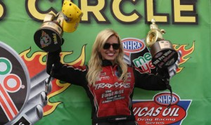 Courtney Force celebrates after scoring the 100th victory be a female driver in NHRA pro competition Sunday at Heartland Park Topeka. (Ivan Veldhuizen Photo)