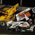 Ian Madsen (18) battles A.J. Bruns during Friday's MOWA Sprint Car Series event at Lincoln (Ill.) Speedway. (Mark Funderburk Photo)