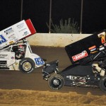 Joey Moughan (83) leads Chris Malone during Saturday's MOWA Sprint Car Series event at Clay County Speedway. (Mark Funderburk Photo)