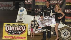 Mitch Wissmiller celebrates after winning at Quincy Raceways on Sunday. (Mark Funderburk photo)