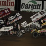 Steve Kinser (11) and Paul McMahan (51) lead the World of Outlaws STP Sprint Car Series event during a restart Saturday at Tri-State Speedway. (Mark Funderburk Photo)