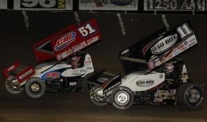 Eventual winner Paul McMahan battles Steve Kinser Saturday night at Tri-State Speedway. (Mark Funderburk photo)