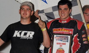 Aaron Reutzel (right) is joined by crew chief Ryan Beechler in Creek County Speedway victory lane Friday night. (The Wheatley Collection Photo)