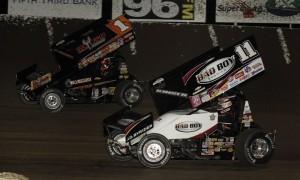 Steve Kinser (11) races under Sammy Swindell at Tri-State Speedway. (Mark Funderburk Photo)