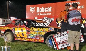Tom Schmitt stands in victory lane after capturing the USRA Stock Car victory Saturday at Deer Creek Speedway. (USRA Photo)