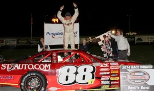 Nick Sweet celebrates victory Friday night at Devil's Bowl Speedway. (MemorEvents photo)