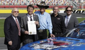 """North Carolina Gov. Pat McCrory (second from left) proclaimed May 2014 as """"Motorsports Month"""" in North Carolina during a press event Thursday at Charlotte Motor Speedway. McCrory was joined by Speedway Motorsports, Inc. Chairman Bruton Smith, NASCAR Hall of Famer and team owner Richard Petty, NASCAR Sprint Cup Series driver Marcos Ambrose and Charlotte Motor Speedway President and General Manager Marcus Smith. (CMS/HHP photo)"""