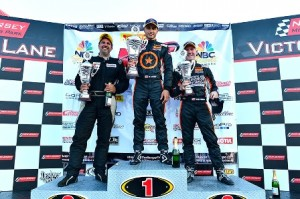 Michael DiMeo (center) picked up another Pirelli World Challenge Touring Car victory Saturday at New Jersey Motorsports Park. (Pirelli World Challenge Photo)