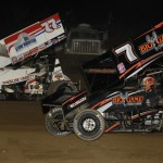 Craig Dollansky (7) races under Wayne Johnson during Friday's World of Outlaws STP Sprint Car Series feature at Wilmot (Wis.) Raceway. (Mark Funderburk Photo)