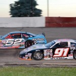 Ty Majeski (91) races under Ricky Baker during ARCA Midwest Tour action at Grundy County Speedway Friday. (Doug Hornickel Photo)