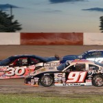 Ty Majeski (91) works the low line under Larry Schuler (30) and Jonathan Eilen during Friday's ARCA Midwest Tour event at Grundy County Speedway. (Doug Hornickel Photo)