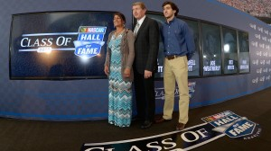 1988 NASCAR Sprint Cup Series champion Bill Elliott (middle) joins his wife, Cindy, and son Chase at the NASCAR Hall of Fame following the announcement of his induction in May. (NASCAR/Getty Images photo)
