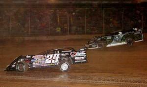 Darrell Lanigan (29) races under Scott Bloomquist Thursday at Pennsylvania's Lernerville Speedway. (Hein Brothers photo)