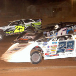 Jimmy Mars (28), Jonathan Davenport (6) and Shane Clanton battle during Friday's World of Outlaws Late Model Series race at Lernerville Speedway. (Hein Brothers Photo)