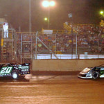Jimmy Owens (20) leads Scott Bloomquist during Friday's World of Outlaws Late Model Series Firecracker 100 preliminary at Lernerville Speedway. (Hein Brothers Photo)