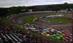 Cars line the front stretch Saturday at Holland NASCAR Motorsports Complex.