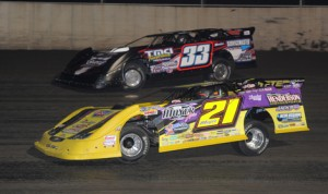 Billy Moyer (21) battles Tim Manville for the race lead during Friday's DIRTcar Summer Nationals stop at Tri-City Speedway. (Don Figler Photo)