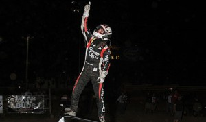 Darren Hagen celebrates his victory in Thursday's Lucas Oil POWRi National Midget Series feature at Quincy Raceways. (The Wheatley Collection Photo)