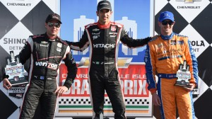 Helio Castroneves, middle, celebrates in victory lane with Will Power (left) and Charlie Kimball after Sunday's Verizon IndyCar Series race. (Al Steinberg photo)