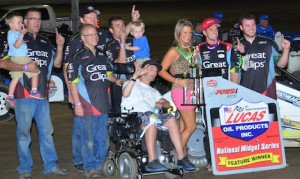Darren Hagen and team owner Shane Hmiel are joined by their crew and friends Saturday at Tri-State Speedway. (Doug Vandeventer photo)