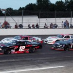 Harrison Burton (12) and Cole Timm (57) lead the PASS South field to the green flag during Saturday's event at South Boston (Va.) Speedway. (LWPictures.com Photo)