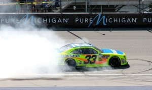 Paul Menard celebrates his victory in Saturday's NASCAR Nationwide Series race at Michigan Int'l Speedway. (Bob Benko Photo)