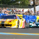 The JMW Motorsports Ferrari 458 Italia leads a prototype entry during qualifying Thursday at Circuit de la Sarthe. (Pete Richards Photo)