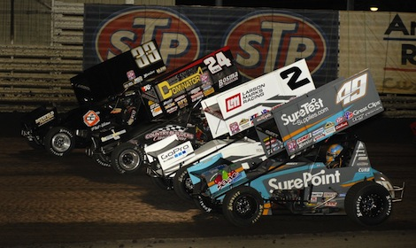 Danny Lasoski (33), Terry McCarl (24), Shane Stewart (2) and eventual winner Brad Sweet during the four-wide parade lap Saturday at Knoxville Raceway. (Mark Funderburk photo)