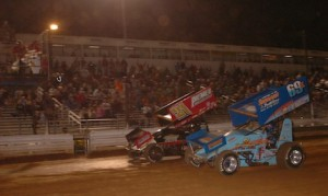 Donny Kreitz (69k) and Brian Monteith race to the checkered flag Friday night at Williams Grove Speedway. (Hein Brothers photo)