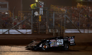 Darrell Lanigan crosses the finish line to win Thursday's Firecracker 100 preliminary at Lernerville Speedway. (Joe Secka/JMS Pro Photo)