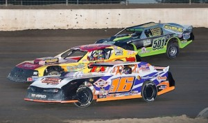 Jeff Koz (16) Frank Paladino (27) and Emily Gade race for the lead during the early stages of the Thunderstock feature at Limaland Motorsports Park. (Mike Campbell photo)