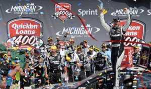 Jimmie Johnson celebrates his third NASCAR Sprint Cup Series victory of the year Sunday at Michigan Int'l Speedway. (NASCAR Photo)