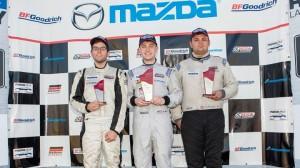Ben Albano, center, notched is first Skip Barber MAZDASPEED Pro Challenge win at Mazda Raceway Laguna Seca. (Myles Regan photo)