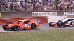 Junior Miller (69) tried to hold off Burt Myers on Saturday at Bowman Gray Stadium, but couldn't do it on the final lap after Myers tapped Miller out of the lead. (BGS photo)