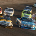 Jeb Burton (13) and German Quiroga (77) lead a pack of trucks during Saturday's NASCAR Camping World Truck Series event at Gateway Motorsports Park. (Don Figler Photo)