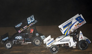 Jac Haudenschild (9w) races under his son, Sheldon, during the dash Wednesday night at Ohio's Atomic Speedway. (Mike Campbell photo)