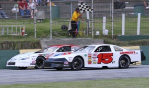 Joey Laquerre (15vt) beats Shawn Fleury to the finish line to win the late-model feature Thursday at Thunder Road Int'l Speedbowl in Barre, Vt. (Leif Tillotson Photo)