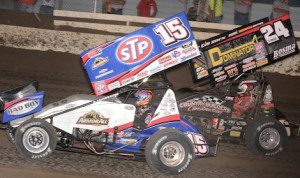 Donny Schatz (15) races under Terry McCarl en route to his 154th World of Outlaws STP Sprint Car Series victory. (Ken Simon photo)