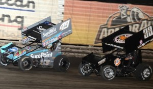 Brad Sweet (49) leads Danny Lasoski Saturday night at Knoxville Raceway. (Ken Simon photo)