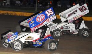 Donny Schatz (15) battles David Gravel Sunday night at Wisconsin's Cedar Lake Speedway. (Ken Simon photo)