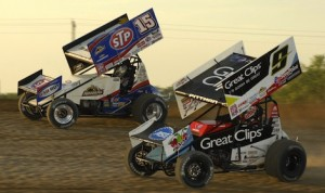 Eventual feature winner Donny Schatz (15) battles Daryn Pittman during a heat race Saturday at Michigan's I-96 Speedway. (Mark Funderburk photo)