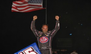 Donny Schatz celebrates victory at I-96 Speedway earlier this year. (Mark Funderburk photo)